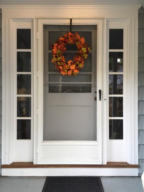 front door with autumn wreath