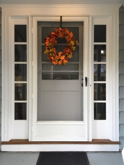 front door with autumn wreath